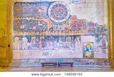 MTSKHETA GEORGIA - JUNE 6 2016: The restored fresco in Svetitskhoveli Cathedral with the Beast of Apocalypse figures of Zodiac and the medieval nobility and clergy on June 6 in Mtskheta.