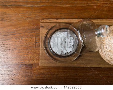Rock Sugar In Glass Bottle On Wooden Table