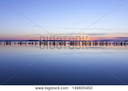 Groyne in Jasmunder Bodden lagoon at sunset