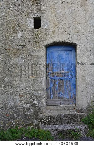 An old wooden door in a derelict building the village of Oblizza Friuli north east Italy.