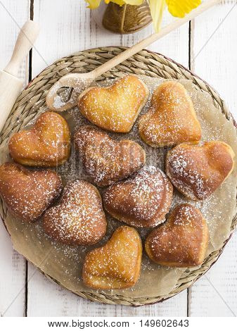 sweet heart shaped donuts with powdered sugar