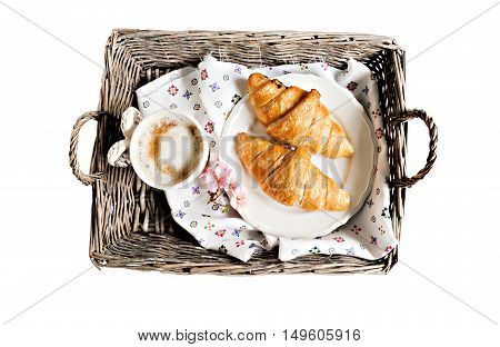 croissants coffee cup flower in romantic style on a wicker tray isolated.