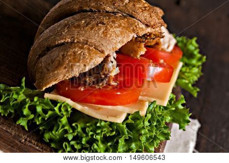 Grain Croissant Sandwich On A Whiteboard And A Dark Background