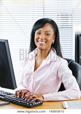 Happy Black Businesswoman At Desk
