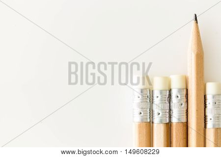 Pencils With Eraser Side Up, Onewith Tip Standing Out, On White Background With Copy-space.pencils W