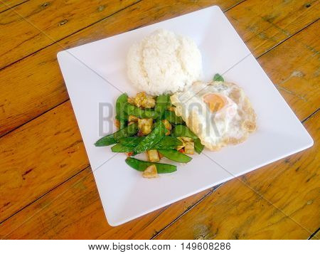 Stir-fried A Fresh Green Peas With Tofu On White Plate. Vegetarian Food, Healthy Food.
