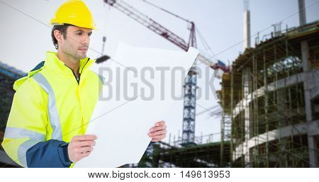 Architect analyzing blueprint over white background against crane and building construction site Crane and building construction site on a sunny day