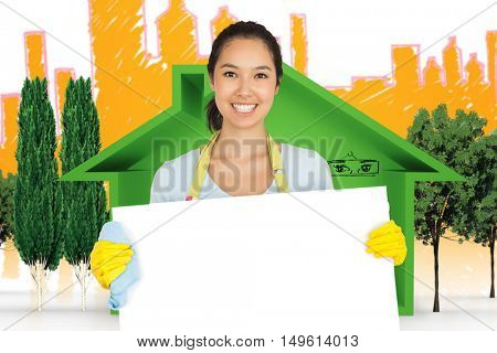 Woman in apron and rubber gloves holding white surface against view of house icon