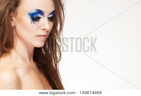 Beauty Portrait Of Woman With Blue Fantasy Make Up