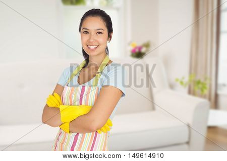 Smiling woman with crossed arms against sitting room