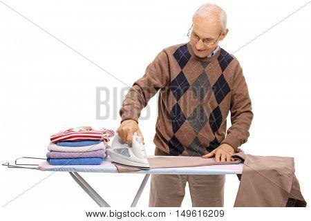 Joyful mature man ironing isolated on white background