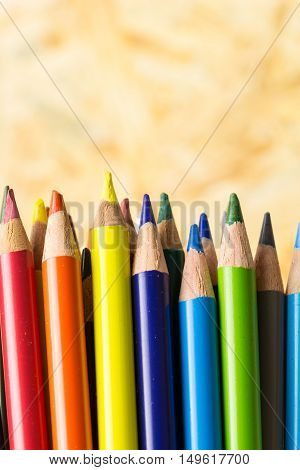 Bunch Of Colorful Pencils, On Blured Wooden Background
