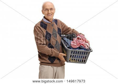 Elderly man holding a laundry basket full of clothes isolated on white background