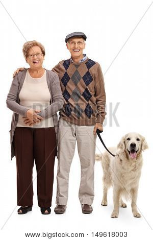 Full length portrait of a happy senior couple posing with their dog isolated on white background