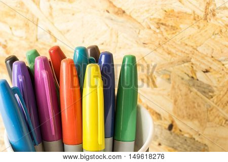 Bunch Of Colorful Markers, On Blured Wooden Background