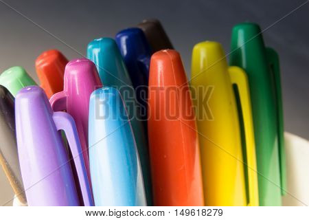 Bunch Of Colorful Markers, On Blured Dark Background