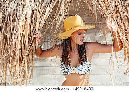 Happy Woman Wearing A Hat Comming Out From Behind Reeds
