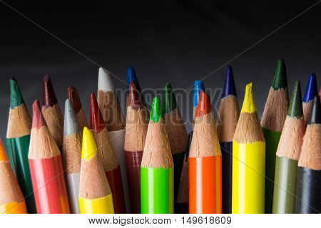 Bunch Of Colorful Pencils, On Blured Dark Background