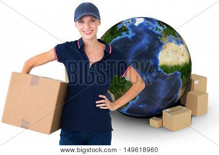 Happy delivery woman holding cardboard box against globe and cardboard boxes