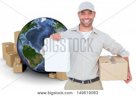Delivery man with cardboard box showing clipboard against globe surrounded by cardboard boxes