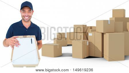 Happy delivery man with package and clipboard against arrangements of cardboard boxes