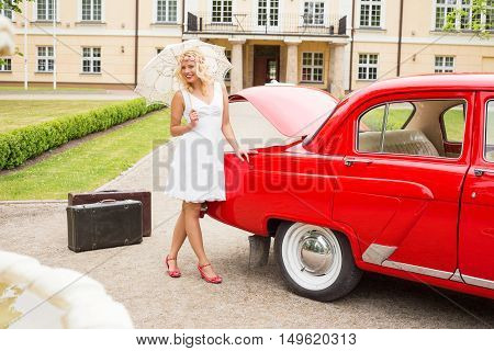 Bright and happy woman with red retro car