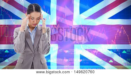 Portrait of a beautiful businesswoman having a headache against digitally generated uk national flag