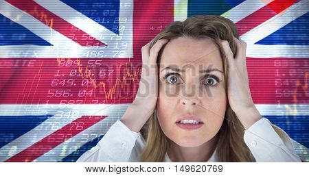 Stressed businesswoman with hands on her head against digitally generated uk national flag