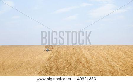Harrowing the soil in spring in Ukraine.