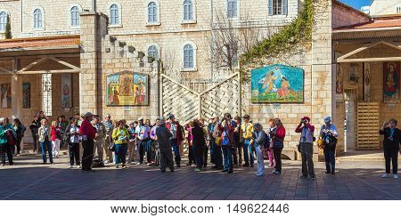 Nazareth, Israel - February 21, 2013: Tourists Near Annunciation Cathedral
