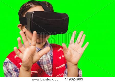 Boy wearing virtual reality headset against green vignette