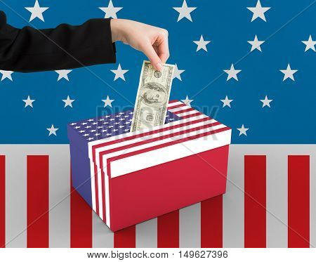 Businesswomans hand holding hundred dollar bill against cardboard box with american flag print