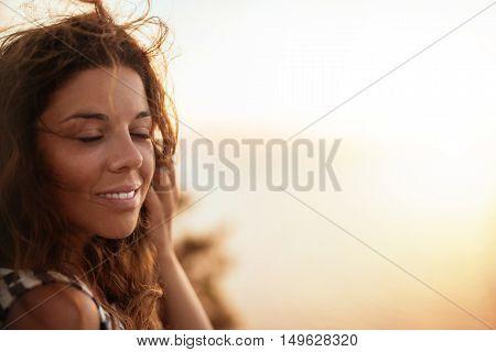 Young and beautiful girl enjoying the golden hour.