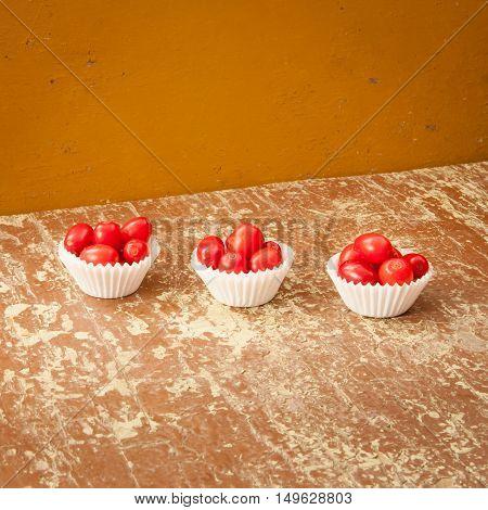 Fresh ripe dogwood berries in white paper baskets
