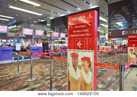 SINGAPORE - AUGUST 28, 2016: Emirates check-in counters at Singapore Changi Airport. Emirates is an airline based in Dubai, United Arab Emirates.