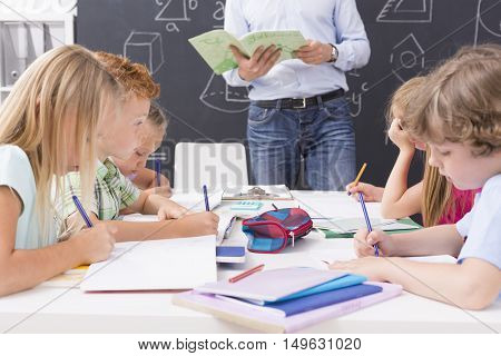 Shot of a group of focused primary school students during a math lesson