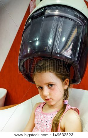 Cute Little Girl In Hairdressing Saloon