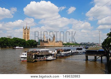 London, United Kingdom - June 21, 2014. View from the Lambeth Bridge in London toward the Houses of Parliament on the Thames River waterfront.