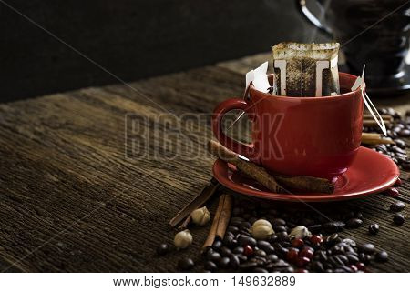 coffee cup background with coffee beans on the table