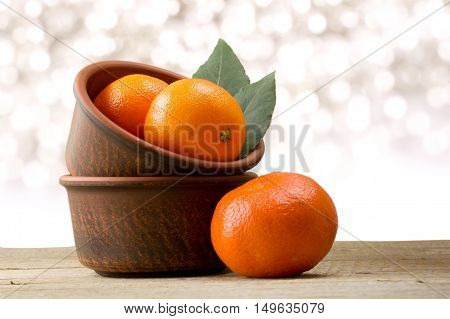 Mandarins on a wooden background. Christmas decor background.