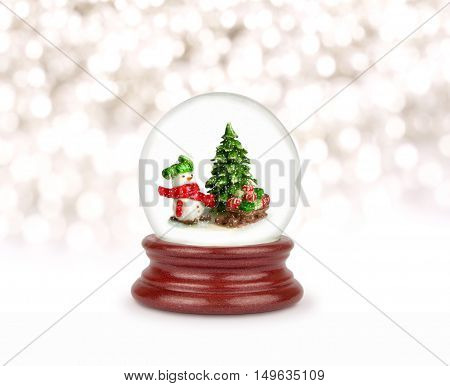 Christmas snow globe isolated on white. Can be used as a Christmas or a New Year gift or symbol. Snowman with gifts.