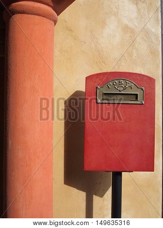 red mailbox on fresco wall background with pillar