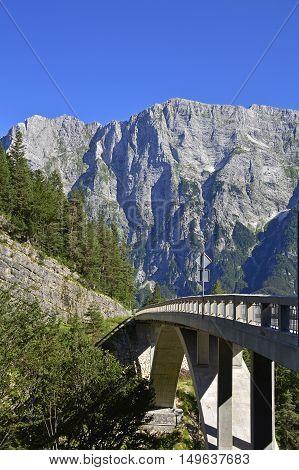 The Slovenian side of the Italian Slovenian border near the start of the Mangrt road. This road crosses the Predelica Ali Predilnica river.