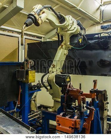 Robots welding  machine in a car production factory