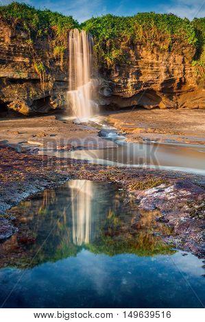 Beautiful waterfall near the beach at Melasti Beach Bali Indonesia.