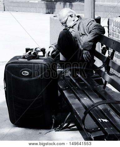 April 8th 2014 Los Angeles California  Image Of a traveler sleeping In a Park.