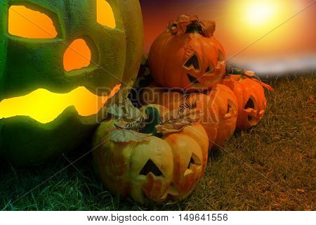 Halloween Pumpkin In A Mystic Forest At Night.Horror background with autumn valley with spooky pump pumpkins . Space for your Halloween holiday text.