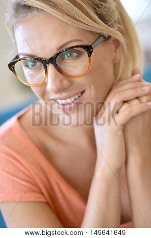 Portrait of blond woman wearing eyeglasses
