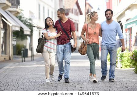 Young people on vacation walking in city street