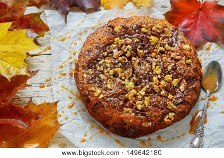 Homemade Pumpkin Pie With Chocolate, Nuts And Caramel. Selective Focus